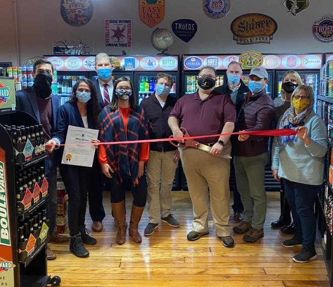 Amesbury Chamber of Commerce Executive Director Phil DeCologero, State Sen. Diana DiZoglio, D-Methuen, and State Rep. James Kelcourse, R-Amesbury, joined Aaron Cunningham and his staff at a ribbon cutting ceremony at RMA Craft Beer and Wine, a new store in Amesbury.