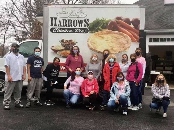 The GFWC Marlborough Junior Woman's Club recently completed another Harrows Chicken Pies fundraiser. This year, Juniors sold 780 pies. In the photo, MJWC members take a break from sorting and delivery.