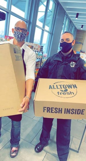 Chef Joshua Smith and the Alltown Fresh team in Plymouth cooked and donated Thanksgiving dinner to the Plymouth Police Department.