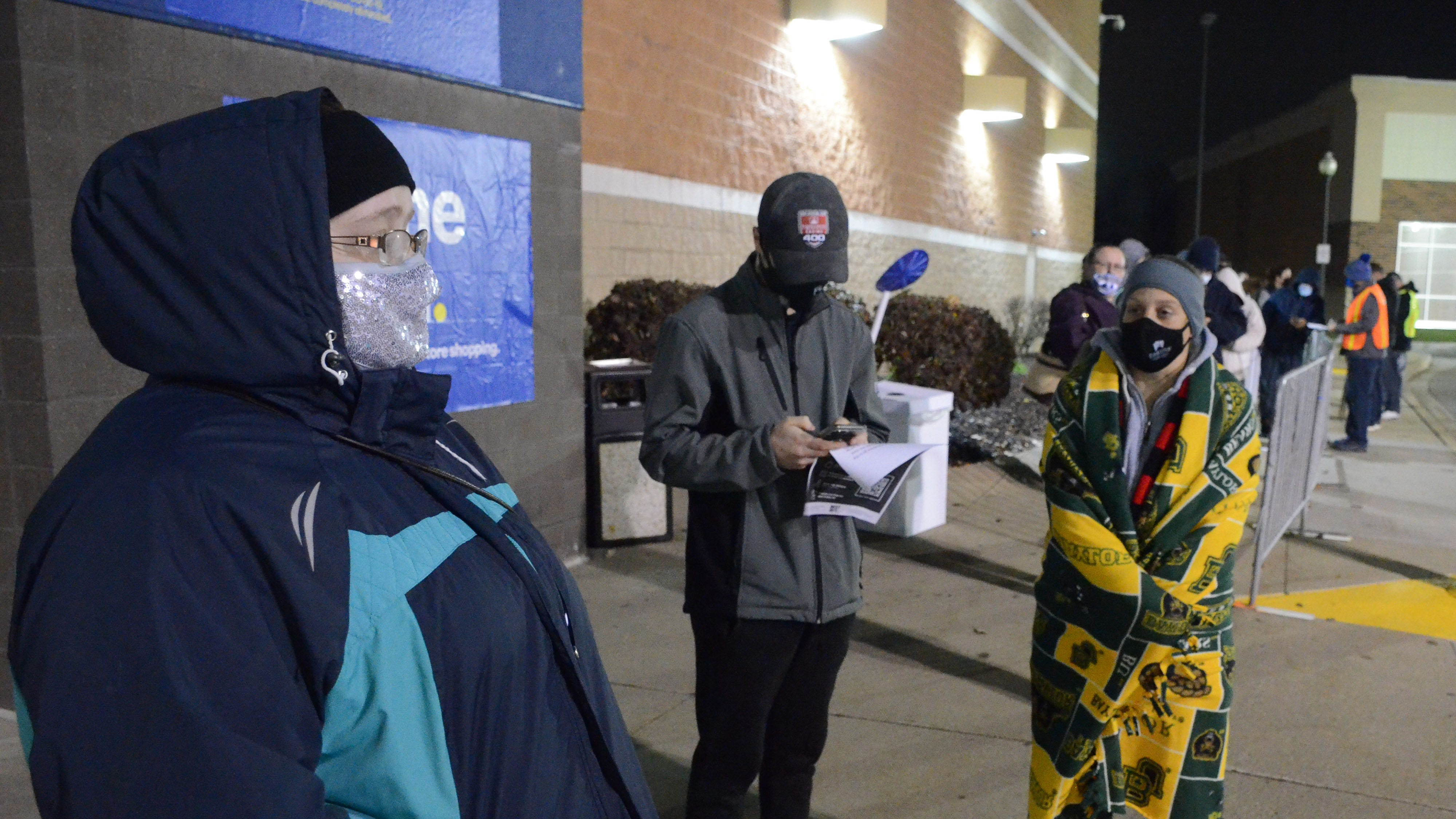 Shoppers wait in line and in the cold for Black Friday bargains