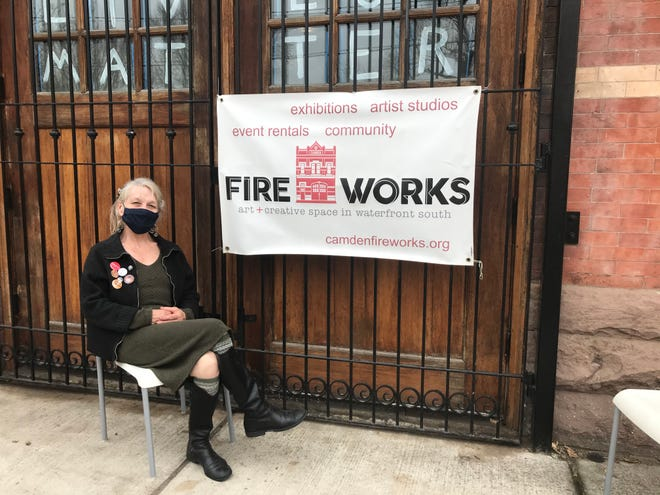 Cassie MacDonald sits outside Camden FireWorks, the gallery, studio and event venue she's led for 10 years.