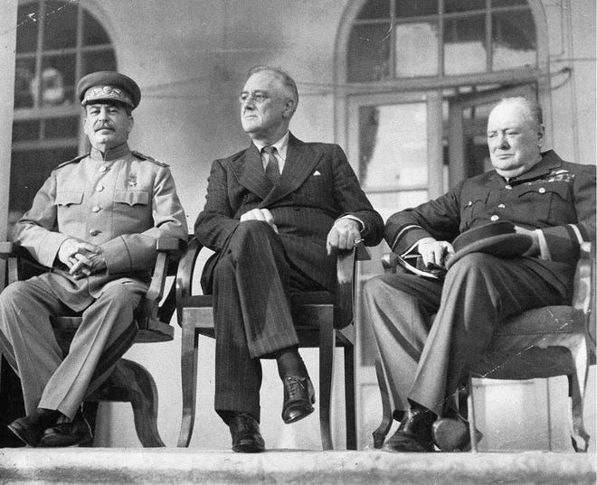 From left to right: Joseph Stalin, Franklin D. Roosevelt, and Winston Churchill on the portico of the Russian Embassy during the Tehran Conference to discuss the European Theatre in 1943.