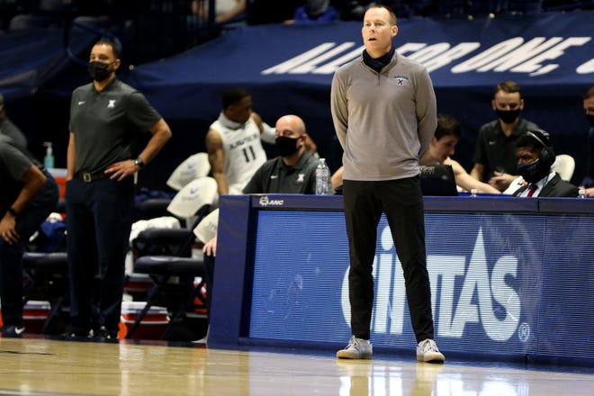 Xavier University head coach Travis Steele instructs his team as they face Toledo at the Cintas Center Friday, November 27, 2020.