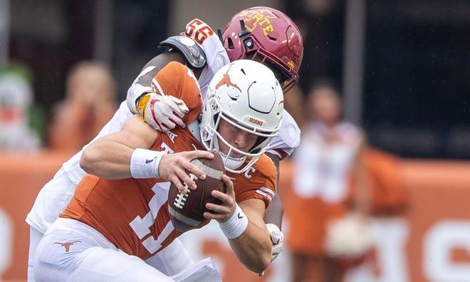 Iowa State Cyclones defensive lineman Latrell Bankston (56) sacks Texas Longhorns quarterback Sam Ehlinger (11) in the second quarter of the Nov. 27 game at Darrell K Royal-Texas Memorial Stadium in Austin. Bankston announced on Dec. 23 that he entered the transfer portal.