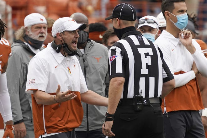 Nov 27, 2020; Austin, Texas, USA; Texas Longhorns head coach Tom Herman argues a call with field judge Jason Ledet in the fourth quarter of the game against the Iowa State Cyclones at Darrell K Royal-Texas Memorial Stadium. Mandatory Credit: Scott Wachter-USA TODAY Sports