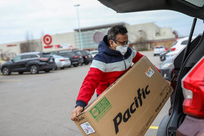Sanjeev Rajanala, 39, of Dearborn purchased a bike for his three-year-old daughter Naisha at Target in Dearborn, Mich. on Black Friday, Nov. 27. 2020 Rajanala says he came to shop looking for a deal, but ended up paying full price.