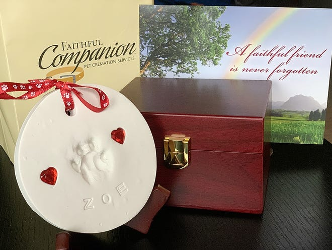 Many services like Faithful Companion Pet Cremation Services offer keepsakes like paw prints of your beloved family member and decorative boxes and urns for their ashes.