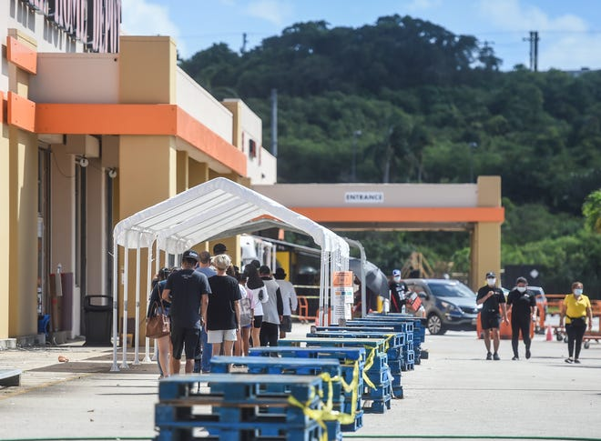 Customers line up outside of Home Depot on Black Friday in Tamuning, Nov. 27, 2020.