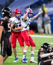 Western Boone sophomore Josiah Smith (14) reacts after kicking the game-winning field goal during the second half against Fort Wayne Bishop Luers in the Class 2A Football State Finals, Friday. Western Boone won 36-35.