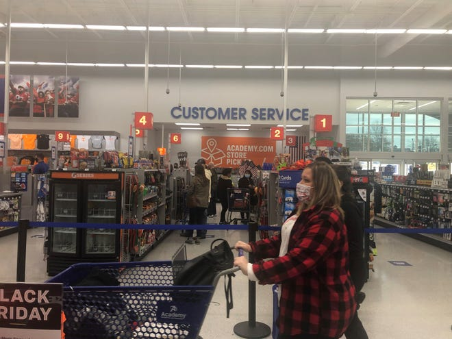 Academy Sports + Outdoors used all of its checkout lanes -  marked with floor signs for customers to be socially distanced - so store associates could get customers through lines faster during Black Friday on Friday, November 27, 2020 in Jackson, TN.