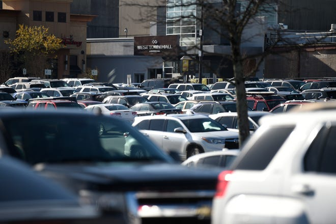 Cars are seen in the parking lot at West Town Mall, on Black Friday, Nov. 27, 2020.