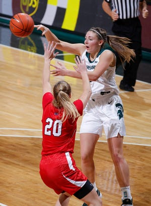 Michigan State's Kendall Bostic, right, passes against St. Francis' Halie Murphy, Friday, Nov. 27, 2020, in East Lansing, Mich. MSU won 77-44.