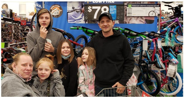 The children of the Timmie Jenkins family of Ontario received new bicycles from Sertoma Club of Mansfield. The parents and three of four children are deaf. Austin, 14, is the oldest of the children and is the only family member who can hear, according to Sertoma Club.