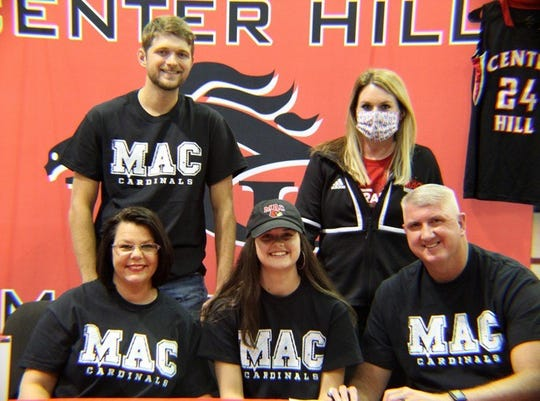 Center Hill's Hope Mealer signed a scholarship to continue her basketball career at Mineral Area College on Nov. 24, 2020. She is joined by her parents, Newton and Jennifer, her brother, Jake, and MAC coach Briley Palmer.