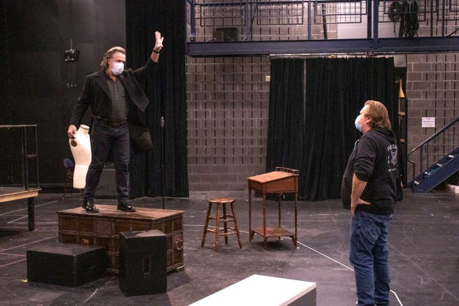 "Actor Lee E. Ernst, left, and director Mark Clements rehearse ""Jacob Marley's Christmas Carol"" at the Milwaukee Repertory Theater. The virtual production will be available for streaming beginning on Dec. 10."