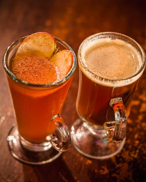 Hot drinks at Maxwell Mansion, Lake Geneva, include American Tart (left) and Hot Buttered Rum made with a housemade butter batter.