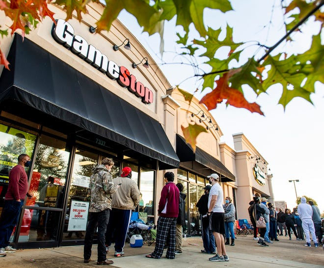 Shoppers wait to enter GameStop at EastChase on Black Friday in Montgomery, Ala., on Friday morning November 27, 2020.