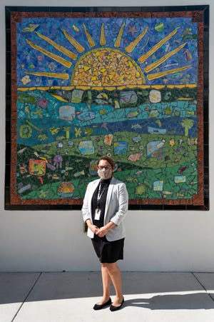 """Principal Zulaika Quintero, who is the daughter of migrant farmworkers and grew up in Immokalee, poses for a portrait at RCMA Immokalee Community School on Wednesday, November 18, 2020. Quintero says the school focuses on reaching out to and supporting the parents of their students because, """"their parents aretheir first teachers at home."""""""