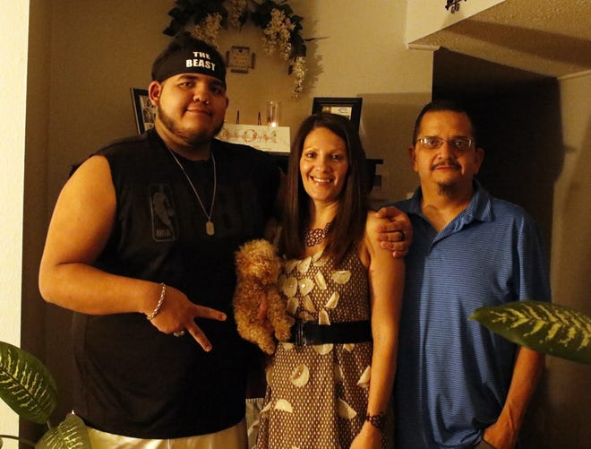 Left to right: Darius, Ashley and Nate Chavarria pose after their Thanksgiving meal on Nov. 27, 2020. Nate Chavarria's pumpkin pie, which is closer in consistency to a mousse than pie filling, was hyped up by Darius and lived up to the billing.