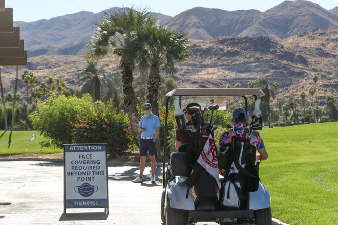 Golfers use face coverings at Tahquitz Creek Golf Resort in Palm Springs, November 27, 2020
