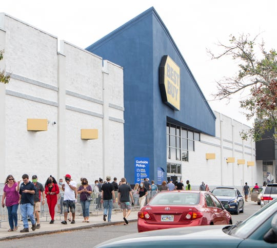 Shoppers wait outside the Best Buy at Pensacola's Cordova Mall on Black Friday.