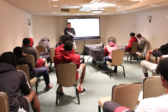 New Mexico State head men's basketball coach Chris Jans leads a meeting at the team's temporary headquarters at the Arizona Grand Resort & Spa.