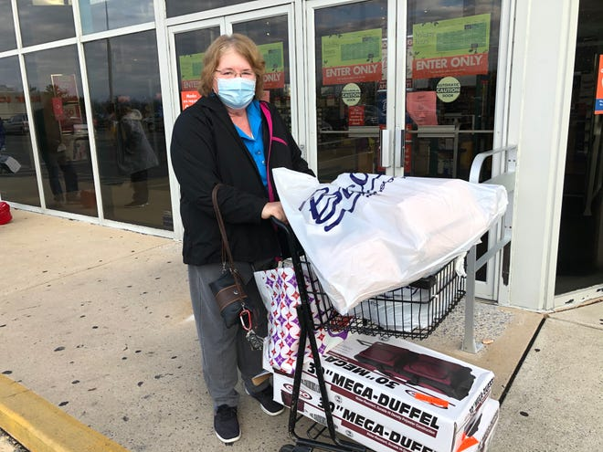 "Deb Keim exits Lebanon Valley Mall's Boscov's on Black Friday. ""I think everyone is wearing masks and trying to be safe,"" she said."