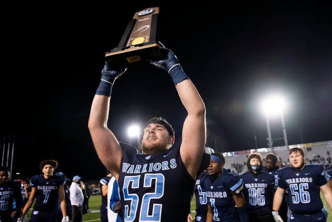 Central Valley senior Josh Campbell (52) holds up the trophy after defeating Wyomissing 35-21 in the PIAA Class 3A championship at Hersheypark Stadium on Friday, November 27, 2020 in Hershey.