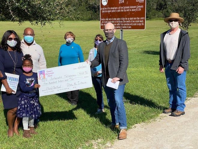 Olivia Ingram donating her Llamanade earnings to Sustainable Tallahassee.