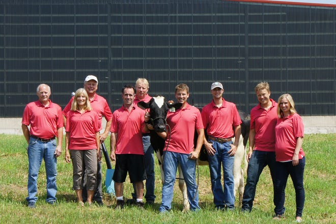 Trim-Bel Valley Dairy Team from left, Kevin Lee, Lanette and Jim Harsdorf, Mark Mitchell, Brian Lee, son Justin Harsdorf, nephew Ryan Bailey, and son Johnathan Harsdorf and his wife, Karissa.