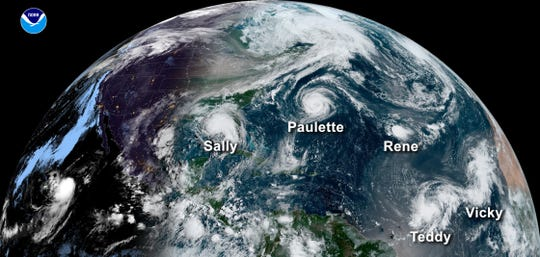 A satellite image from Sept. 14 shows five tropical systems spinning in the Atlantic basin at one time. From left, Hurricane Sally in the Gulf of Mexico, Hurricane Paulette east of the Carolinas, the remnants of Tropical Storm Rene in the central Atlantic and Tropical Storms Teddy and Vicky in the eastern Atlantic.