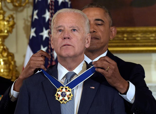 President Barack Obama presents Vice President Joe Biden with the Presidential Medal of Freedom during a ceremony in the State Dining Room of the White House on Jan. 12, 2017.