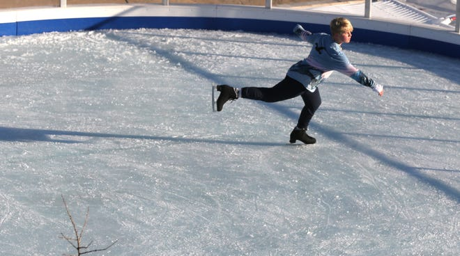 Jaden Swisher 15, of Akron's Goodyear Heights, enjoys the opening of the downtown Cuyahoga Falls ice rink on Saturday.