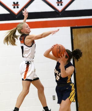 Marlington's Mary Mason, left, leaps to block a pass by Copley's Shelby Emich during their game at Marlington High School Saturday, November 28, 2020.
