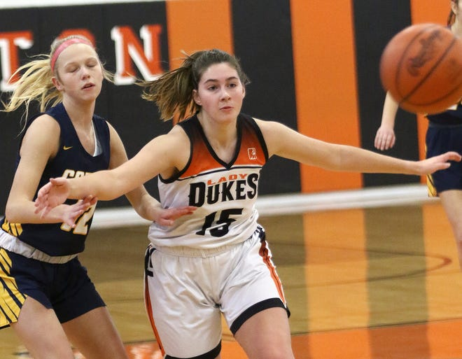 Marlington's Allison Lacher, right, blocks Copley's Emily Kerekes, left, from getting to a loose ball during their game at Marlington High School Saturday, November 28, 2020.