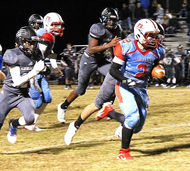 East Beauregard running back Kane Atkinson (with ball) ran for 122 yards and a touchdown in leading the Trojans to a 38-20 win over the Montgomery Tigers in the first round of the Class 1A playoffs Friday night