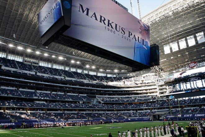 An image of Dallas Cowboys strength and conditioning coordinator Markus Paul is projected on the video screen as all in attendance observe a moment of silence before the game against the Washington Football Team on Thursday. Paul died on Wednesday.