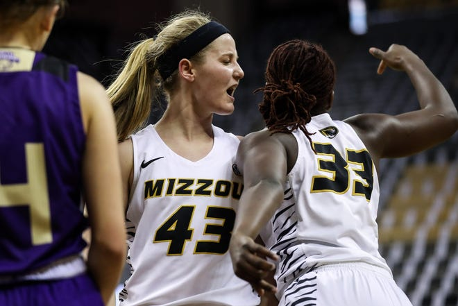 Missouri forward Hayley Frank (43) and guard Aijha Blackwell (33) celebrate during a game against North Alabama on Nov. 27 at Mizzou Arena.