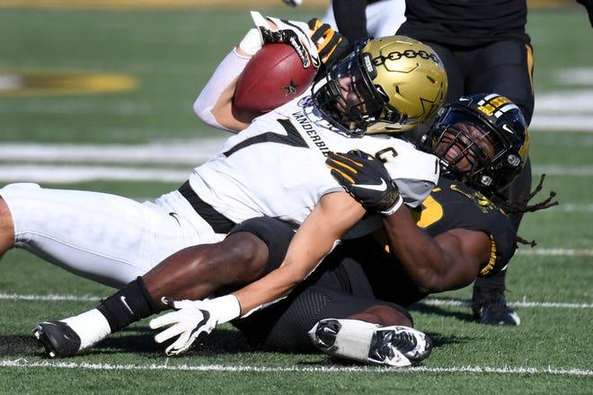 Missouri linebacker Nick Bolton pulls down Vanderbilt wide receiver Cam Johnson (7) during a game Saturday at Faurot Field.