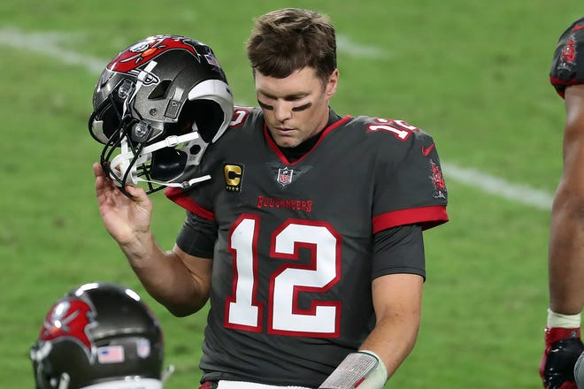 Tampa Bay Buccaneers quarterback Tom Brady (12) reacts as he leaves the field after throwing an interception to Los Angeles Rams strong safety Jordan Fuller during a game Monday in Tampa, Fla.