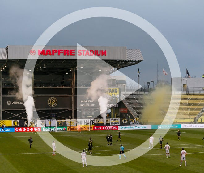 In this file photo, Pyrotechnics fires off after a goal by Columbus Crew SC forward Gyasi Zardes (11) during the second half of the MLS Cup playoff match against the New York Red Bulls at Mapfre Stadium in Columbus on Saturday, Nov. 21, 2020. The Crew won 3-2.