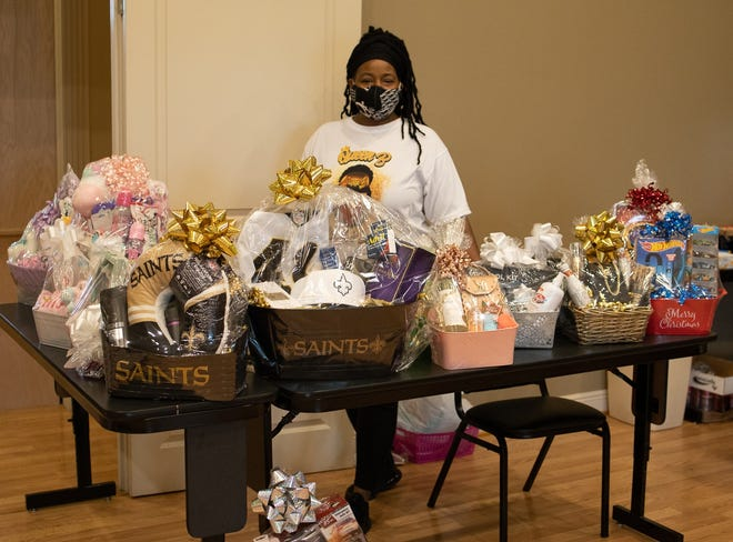 Melissa Clark, owner of Baskets for All Occasions, displays her wares at the Houma-Terrebonne Chamber of Commerce' pop-up on Saturday.