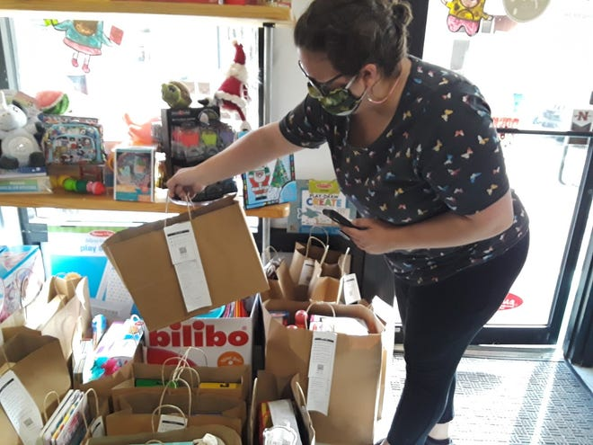 South Coast Baby Company owner Kelly Plair sorts online orders Friday at her Thibodaux store.