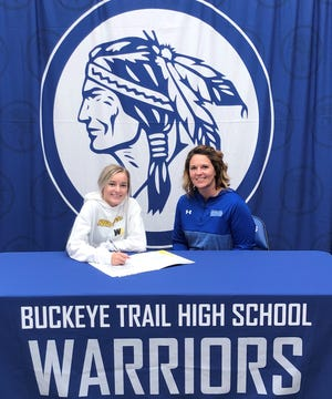 Buckeye Trail senior Jacey Wayble, left, sits beside her mother Shanna after signing her letter of intent to attend West Liberty where she will compete on their Acrobatics and Tumbling team.Acrobatics and Tumbling was newly added to the NCAA Emerging Sports for Women program (in 2020).  Jacey will be competing on the team, while pursuing her goal to earn a BS in Dental Hygiene.
