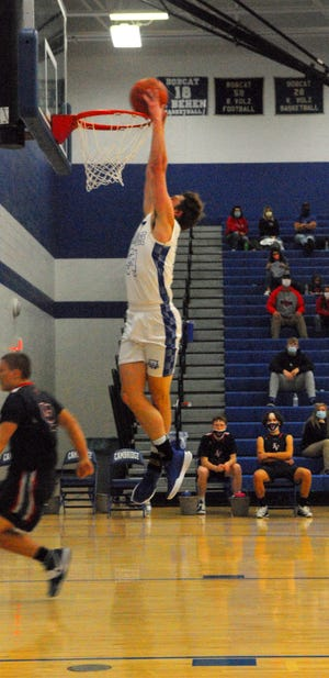 Senior Dominic Cork got the crowd of Gene Ford Gymnasium on their feet when he dunked early in the Cambridge vs. Indian Valley game Friday night.