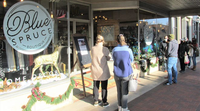 Good weather and sunshine helped make waiting to enter some businesses more pleasant during Shop Small Saturday in downtown Wooster. Customers waited their turn at Blue Spruce Boutique, which limited customers to allow for proper social distancing.