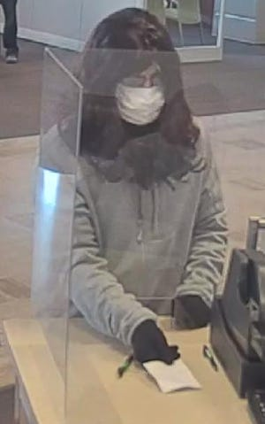 A man wearing a wig and a mask walked off with an undisclosed amount of money from the Huntington National Bank in downtown Ashland Saturday morning, after handing a teller a note demanding cash.