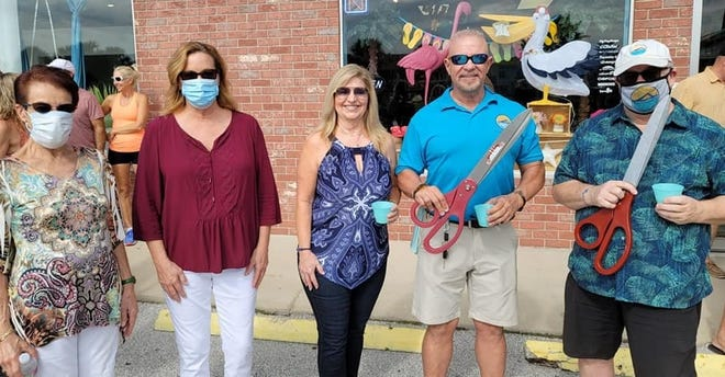 Flagler Beach City Commissioner Jane Mealy, Flagler Beach Mayor Linda Provencher, Flip Flop Shops Flagler Beach co-owners Dana and Rex Galindo, and Flip Flop Shops Director of Franchise Operations Steve Schultz attend the grand opening ribbon cutting in November.