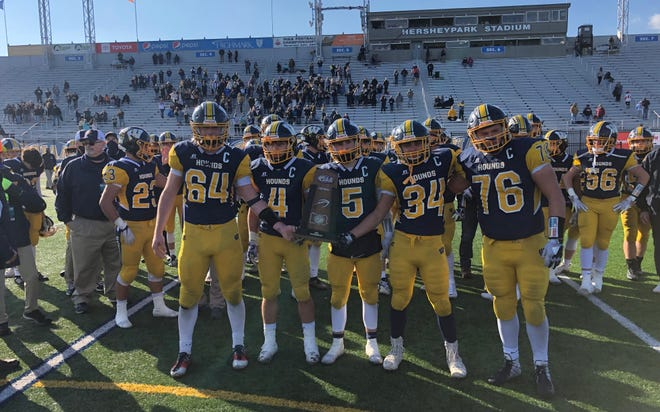 Wilmington captains, from left, Morgan Whiting, Ethan Susen, Caelan Bender, Darren Miller and Weston Phanco hold up the PIAA Class 2A football runner-up trophy. The Greyhounds lost to Southern Columbia 42-14 in the PIAA Class 2A football championship game at Hersheypark Stadium.