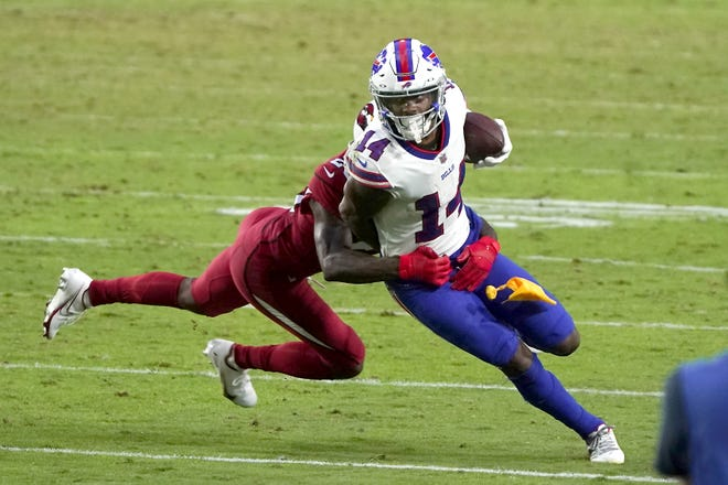 Buffalo Bills wide receiver Stefon Diggs (right) tries to turn upfield after a Nov. 15 reception against the Arizona Cardinals in Glendale, Arizona. Painted rightly or wrongly as yet another one of the NFL's many diva receivers for his various sideline outbursts during his first five seasons in Minnesota, Diggs has put behind his mercurial past by quickly warming up to his new surroundings.